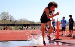 Track honors coach Zach Kindler with meet