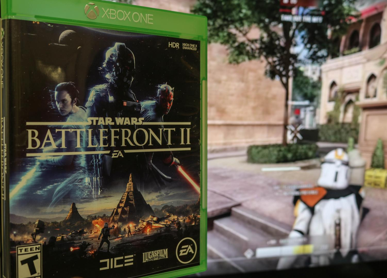 "A gamer plays Galactic Assault on the Naboo map. The trooper aims at enemies to protect the objective. Maps are comprised of various planets of ""Star Wars."""