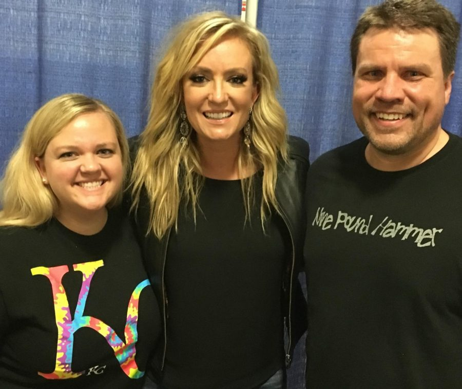 Assistant Professor of Biology Danielle Hemingson and Associate Professor of Exercise Science Chris Todden pose with Clair Dunn at a show in St. Joe, Missouri. Todden and Hemingson are notorious for attending many concerts throughout the summer.