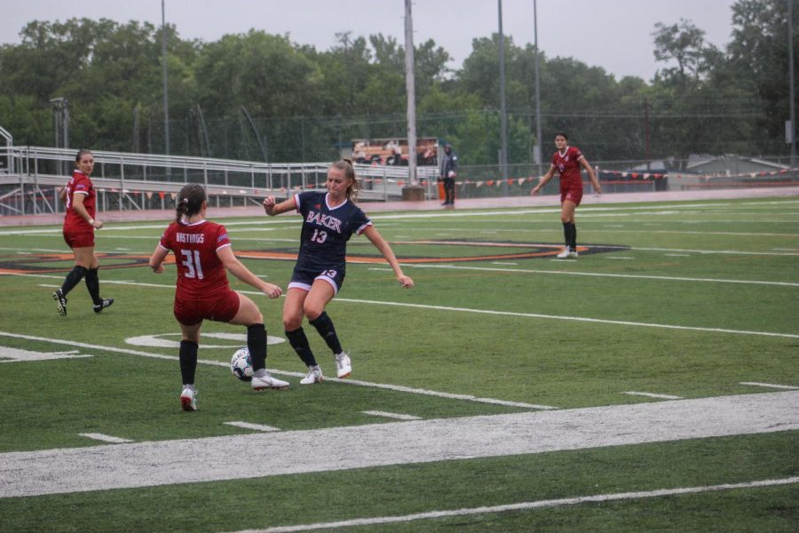 Jenna Lattimer tracks back from her forward position in order to cut of an opponent for and set up a steal opportunity.