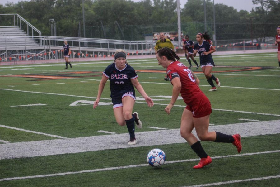 Freshman defender Megan Nolan rushes towards an opponent in hopes to steal the ball. Nolan succeeds and passes it on to a teammate.