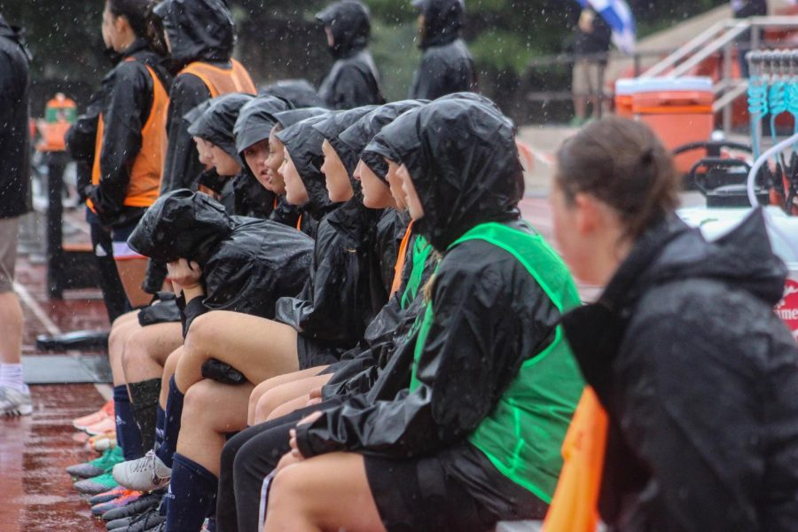 The women's soccer team watch their teammates in the rain during on Friday Sept. 7 in a matchup against Hastings college. The Wildcats could not hang on in their 2-1 loss.