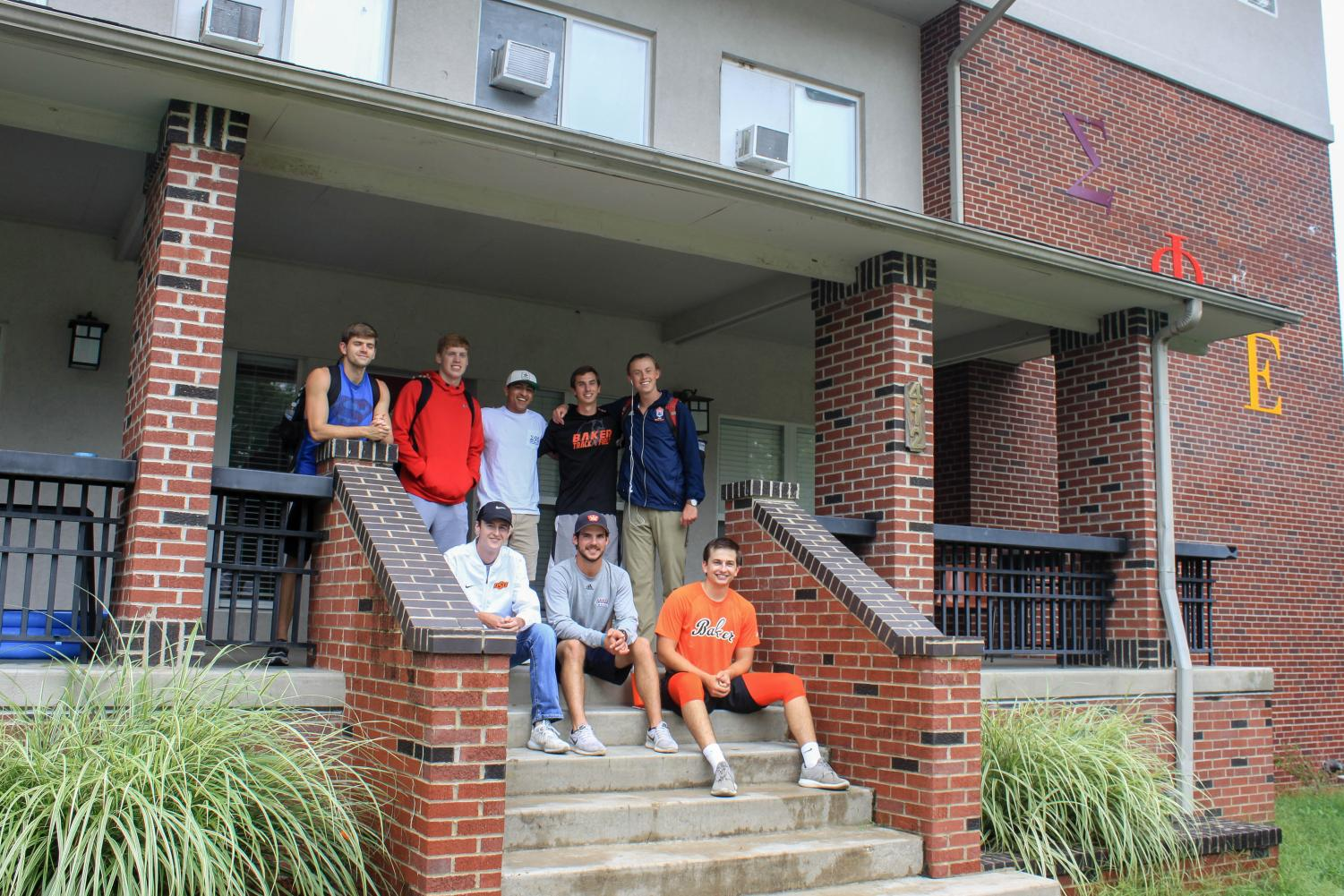 Members of Sigma Phi Epsilon pose in front of their house on Sixth Street across from campus. Sig Ep is the Kansas Alpha chapter, making them the first chapter established in the state. The fraternity welcomed 20 new members into their brotherhood this fall recruitment.