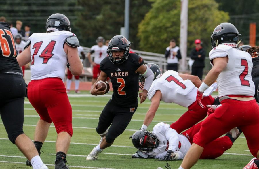 Senior running back Cornell Brown breaks two tackles as he runs for a few yards against Benedictine. The Wildcats fell to Benedictine 23-12.