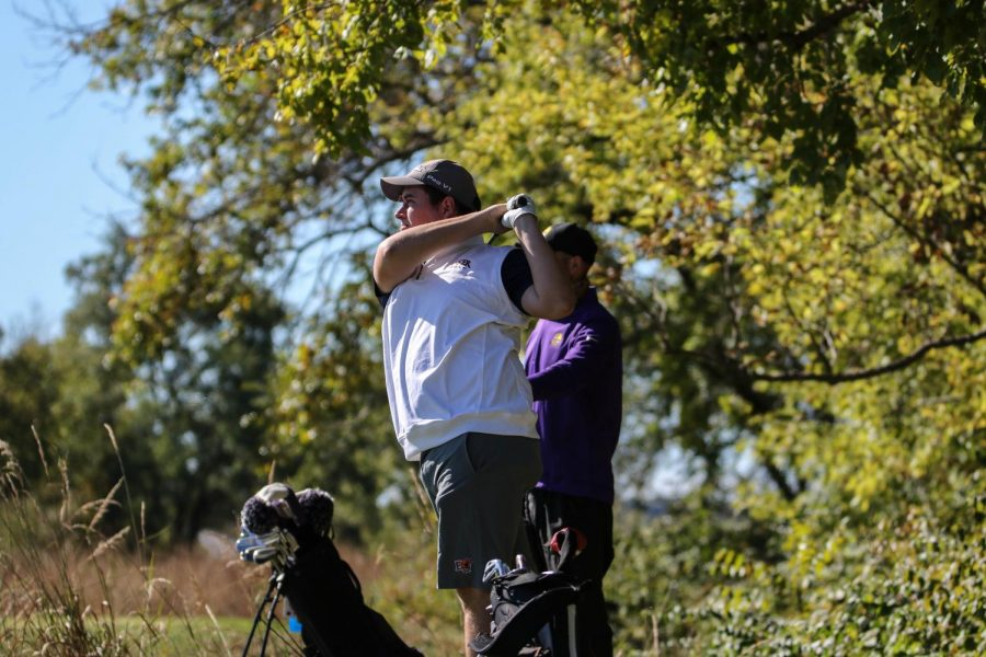 Sophomore Devin Peters watches his drive on the 2nd hole of the Baker Invitational. Peters finished with an overall score of 202 for the Wildcats.