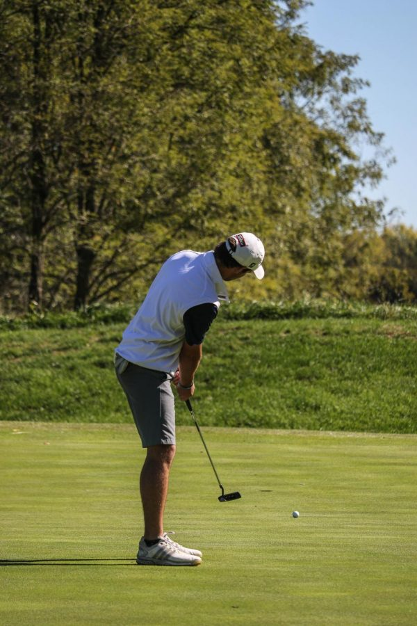 Junior Payton Ruder watches as his birdie putt heads towards the hole. Ruder finished the highest for the Wildcats, taking 11th with a overall score of 156 at the Baker Invitational on Oct. 17-18.