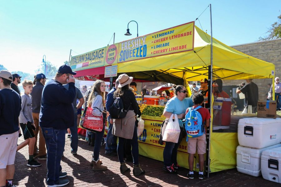 A long line forms in front of the Baker baseball team's booth. The team runs the booth every year at Maple Leaf Festival selling lemonade and limeades.