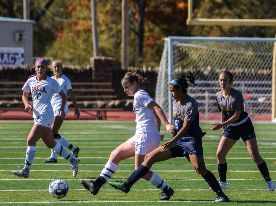Senior forward Sierra McKinney beats an opponent to the ball and passes to teammate down field. McKinney later assisted Jenna Lattimer for the go ahead goal with five minutes remaining.
