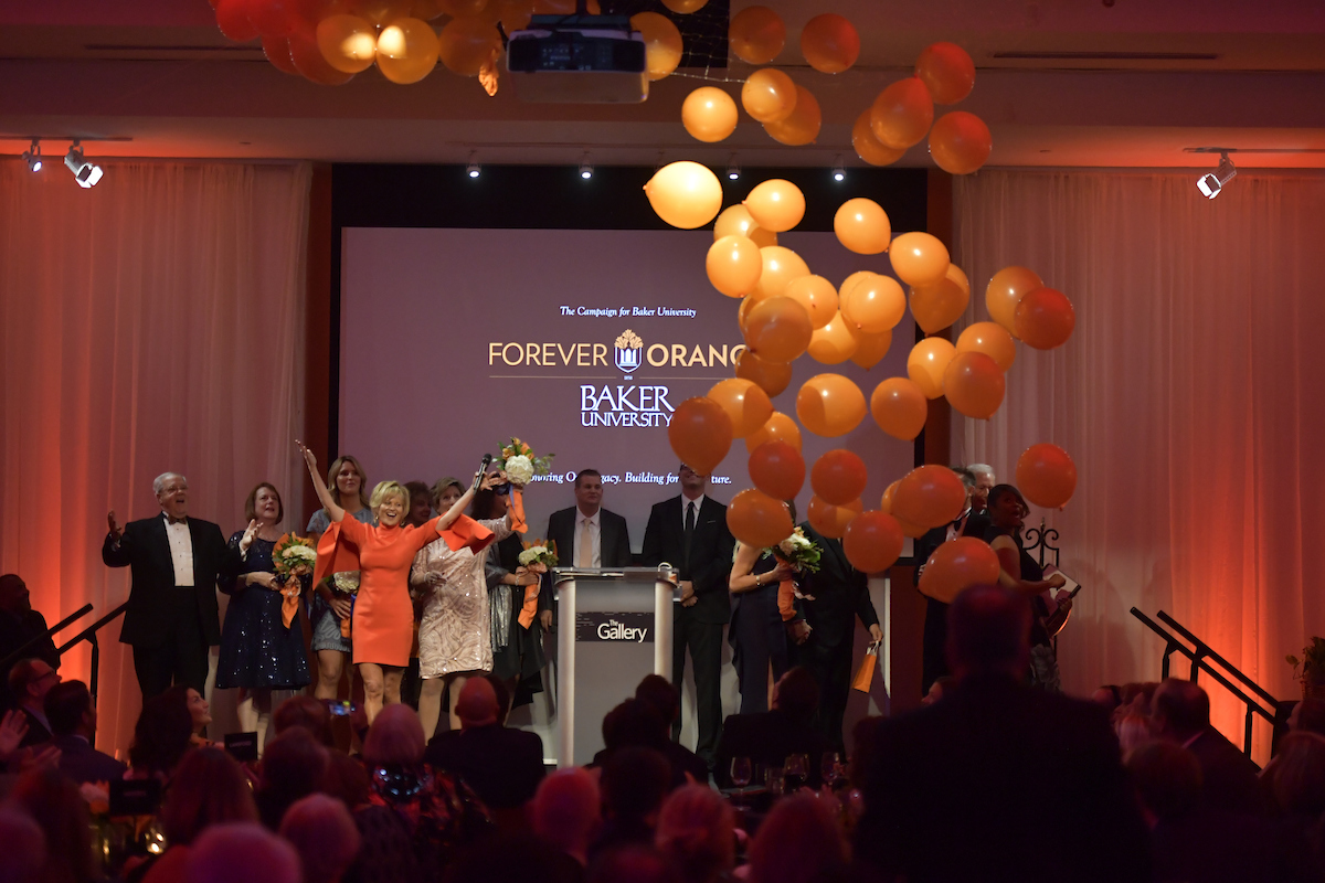 "Alumni and friends of Baker University attend a gala in downtown Kansas City, Missouri Oct. 13. The event was in celebration of the ""Forever Orange"" campaign in order to raise funds for the university."