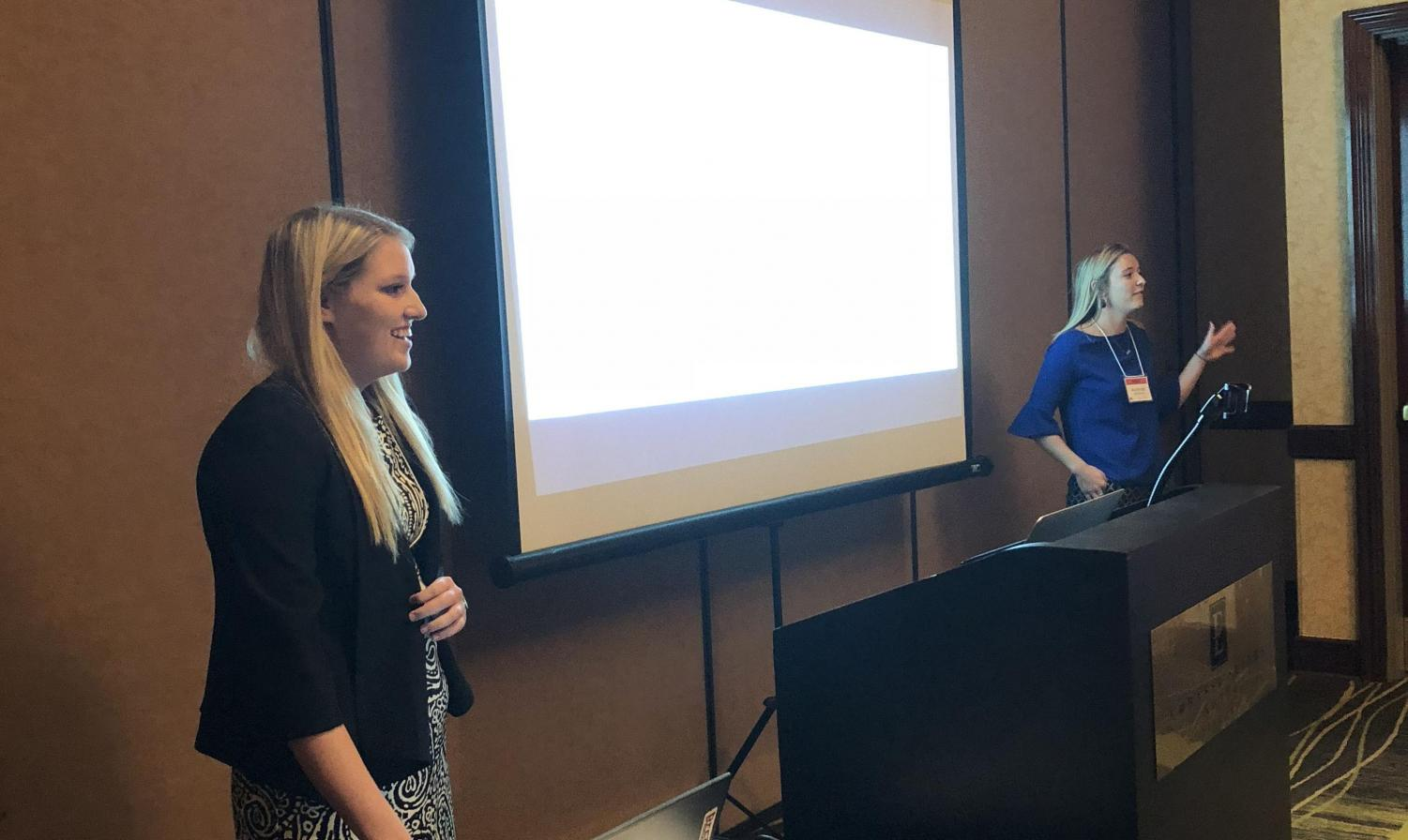 Seniors Madison Lutzs and Hannah Tolliver share their presentation at the Womens Leadership Conference in Nebraska.