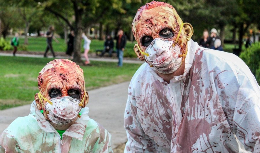 Dayton(left) and Brandon(right) Clevenger use their halloween outfits early this year at the annual Zombie Walk on Oct. 18 in Lawrence.