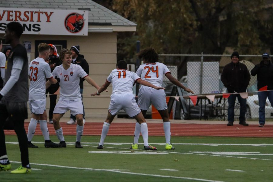 Eren Elbustu and Jordan Alonge celebrate with teammates after Elbustu scored the wildcats second goal to seal the win against LSU-Alexandria in the first round of the NAIA National Championship.
