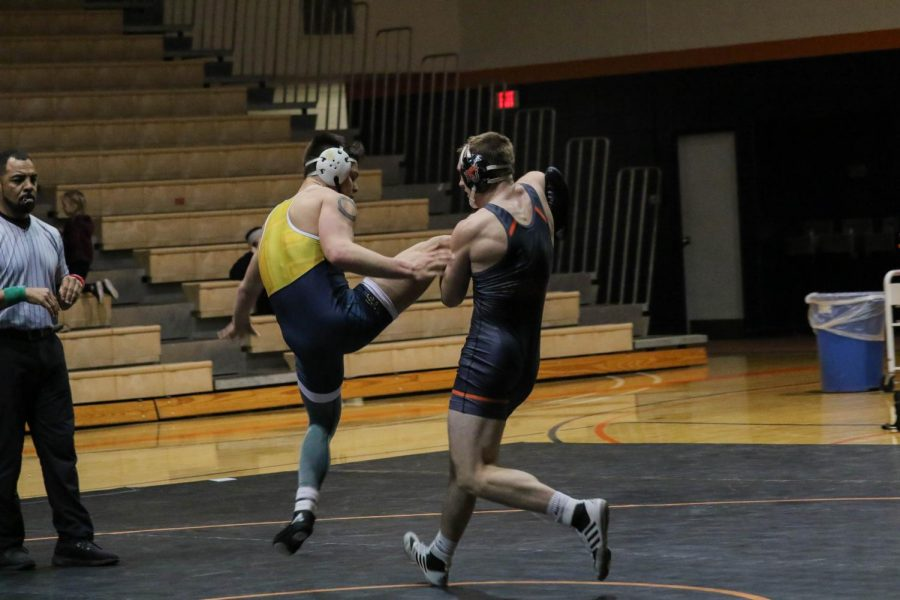 No. 5 ranked Jacob Smith works to finish a single leg attack against his opponent in the Wildcats home opener. Smith finished with a dominant 12-0 major decision over Alex Pham of William Penn.