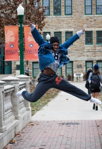 Freshman Stephen Long executes a jump on Taft Bridge on Nov. 30. Long is a member of the dance team including the competition team.