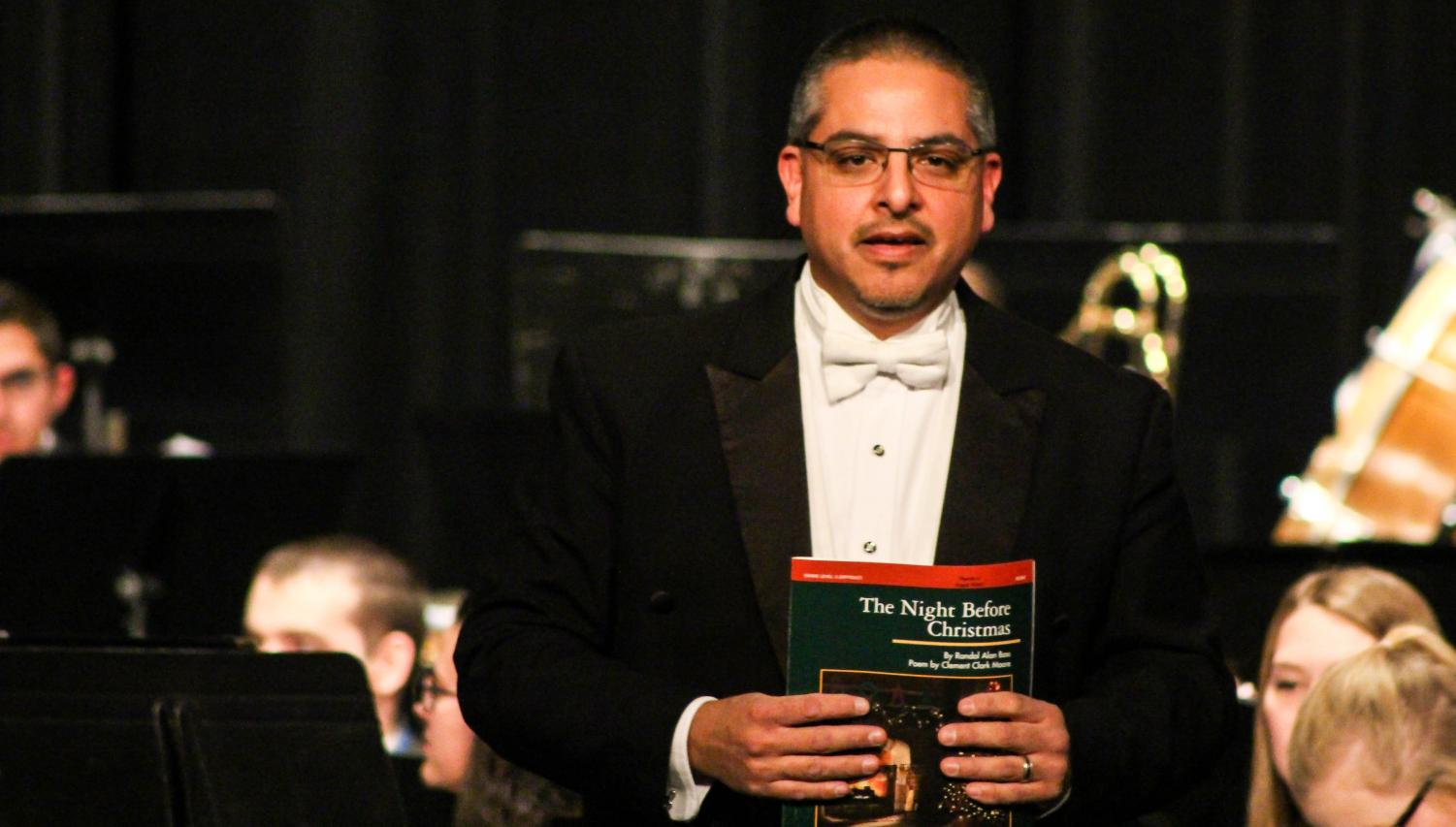 "Frank Perez, director of bands, conducted the concert. Perez lent the baton to his conducting student junior Marget Hempleman for ""The Spirit of Christmas."""