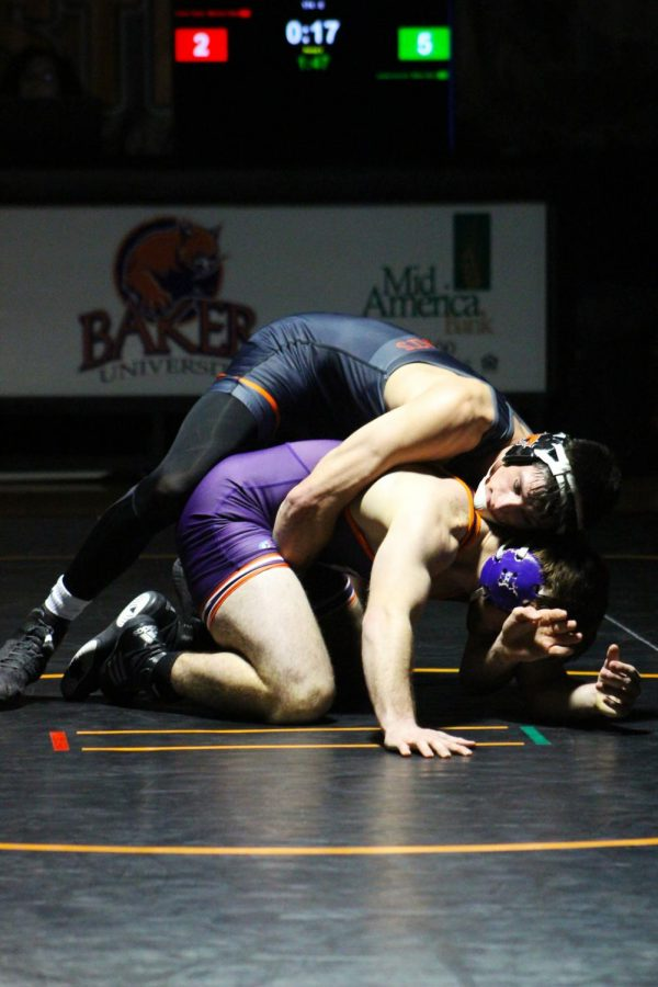 Junior Lucas Lovvorn matches up against Missouri Valley's Dalton Tipton in the 174-pound class at Missouri Valley Dual on Jan. 25. Lovvorn remained undefeated the whole season and became national champion.