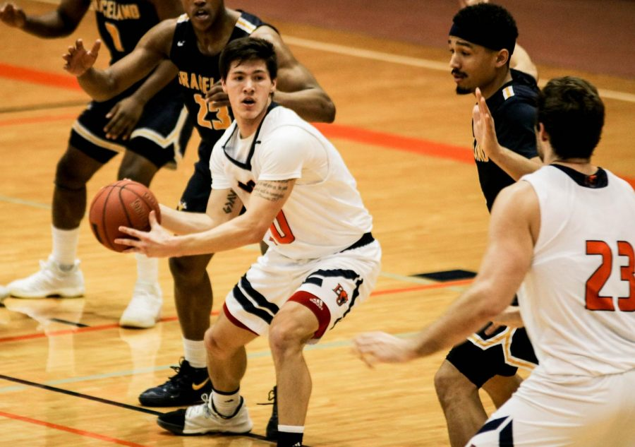Junior Brandon Clifford handles the ball in Wednesdays game against Graceland. The Cats fell 74-88.