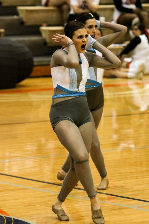 Sophomore Gracie Chambers shows her leadership in the Baker Dance Teams halftime performance.