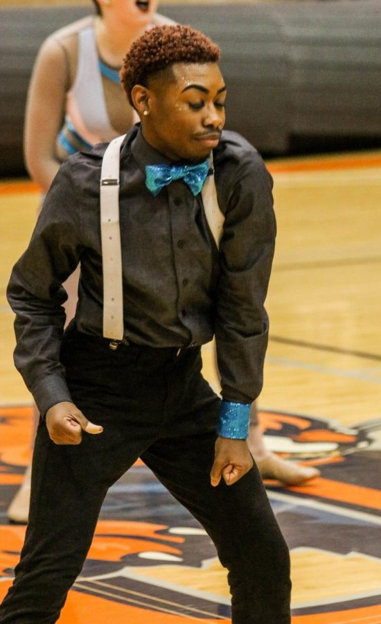 Freshman Stephen Long shows his spunky personality during the half time show at the Baker mens basketball game.