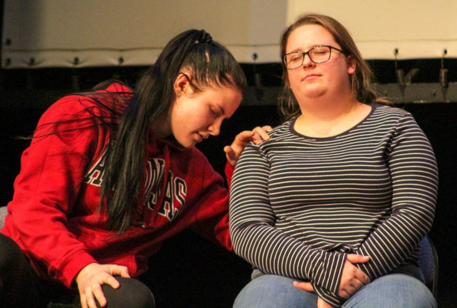 Sophomore Taylor Bell leaning on (no idea) while being hypnotized at the show on Wednesday in Owens Auditorium.