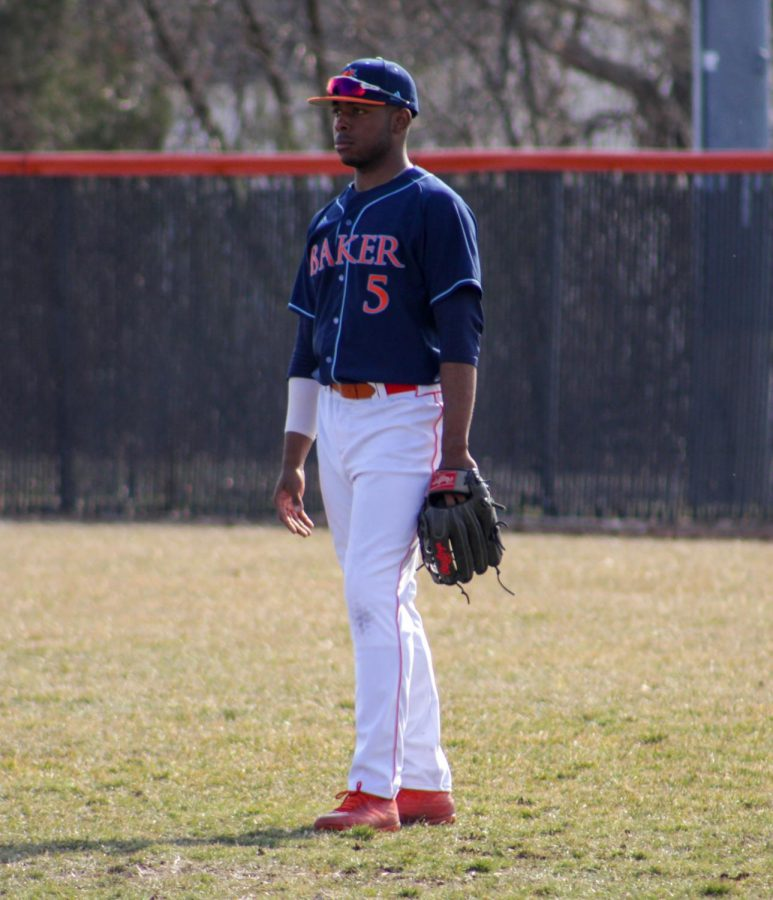 Senior Jason Chambers playing right field at the double header held on Sunday, March 17th against Missouri Valley.
