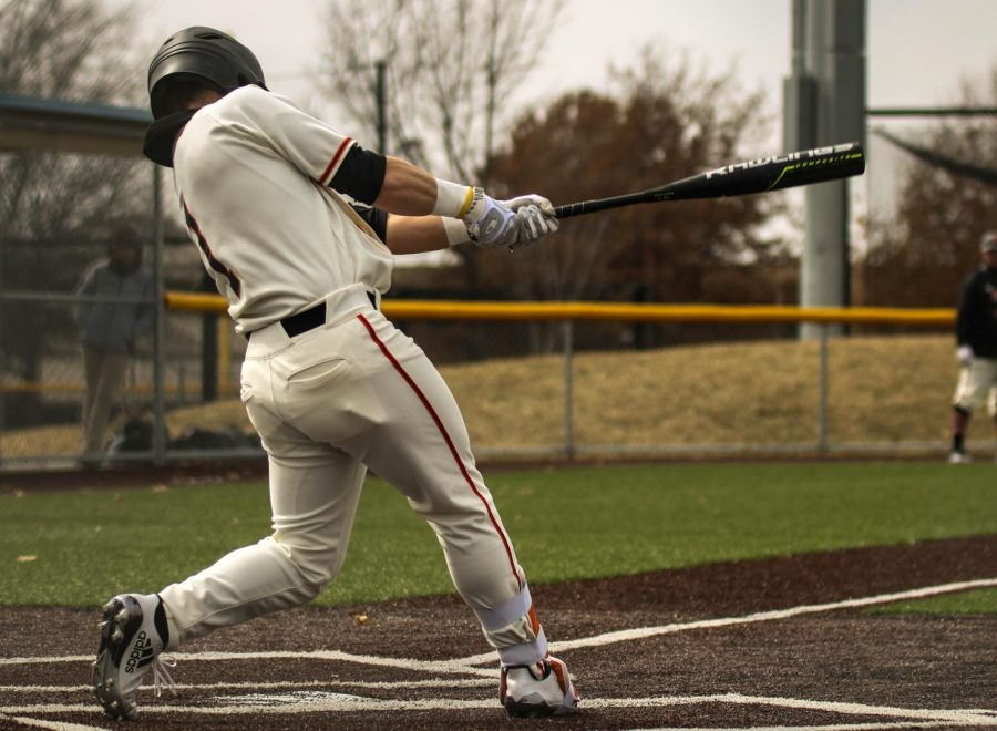 Senior, Cooper Karlin squares up a ball against Midland University. Karlin is currently hitting .400 on the season and is leading the Wildcats going into conference games.