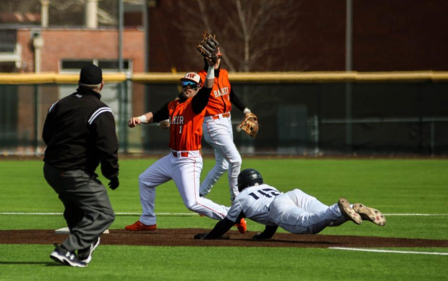 Senior, Cooper Karlin, snags the throw down and gets the out as Clark attempts to steal second base.