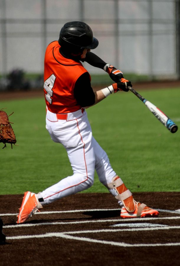 Junior, Bailey Pattin, takes a swing at Lawerence High School in the Conference opener.