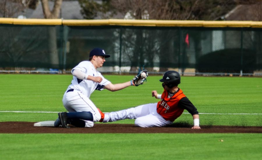 Senior, Cooper Karlin slides under the tag as he steals second against Clark University. Karlin currently has five stolen bases on the year.