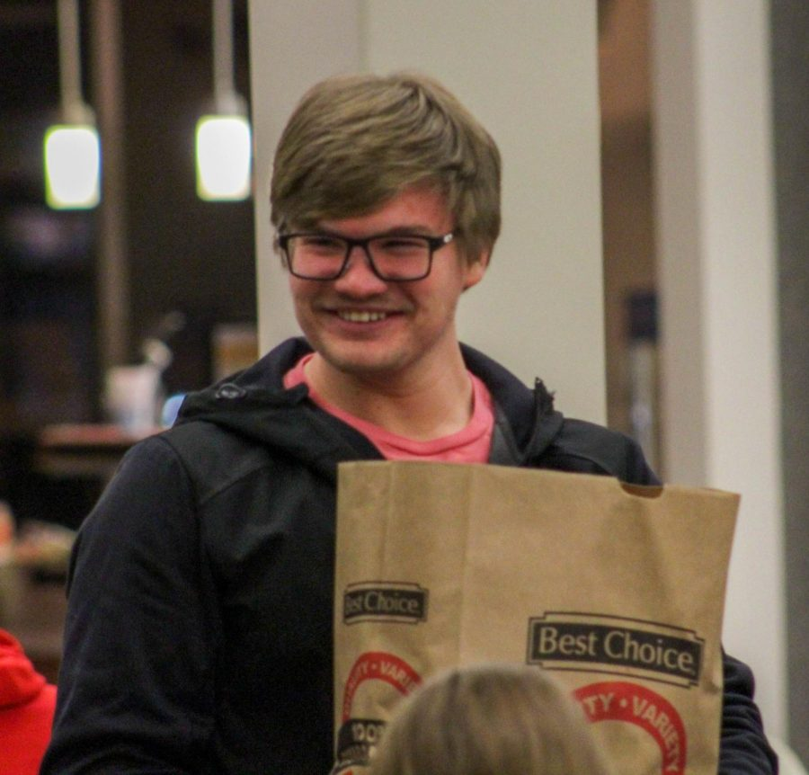 Freshman Cody Lucas is nothing but smiles after winning the second round of grocery bingo.