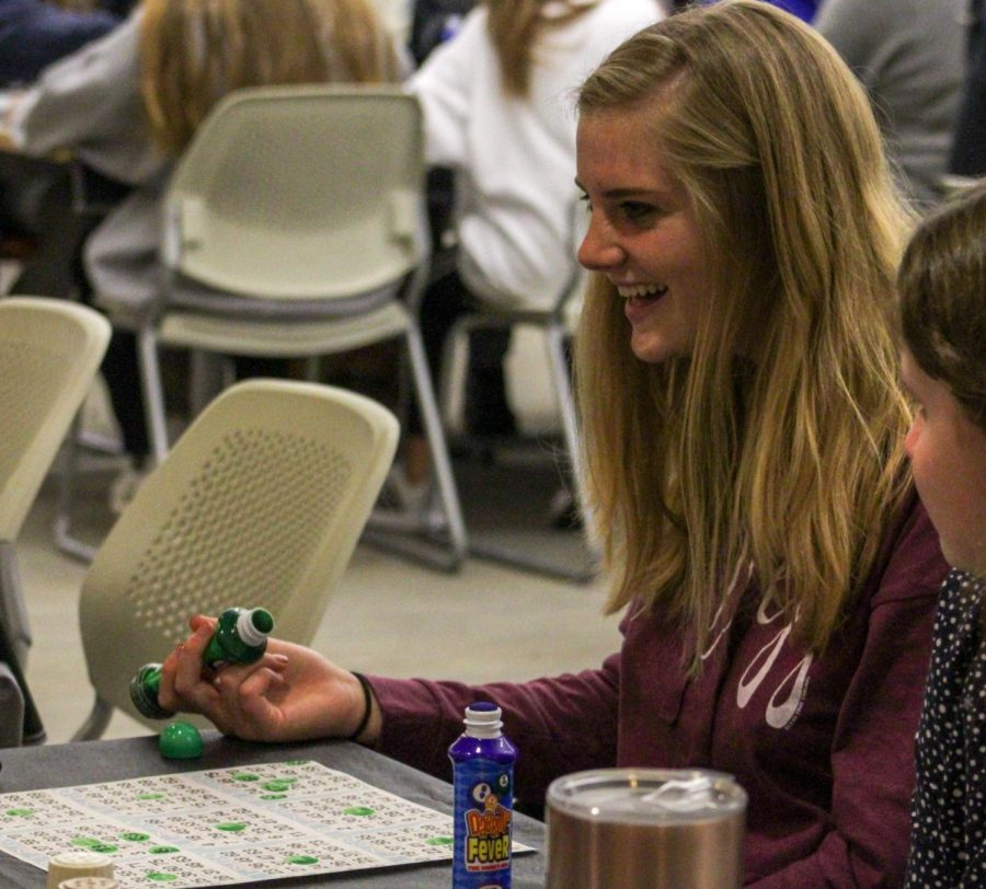 Freshman Taylor Rogers laughing with her friends hoping to win!