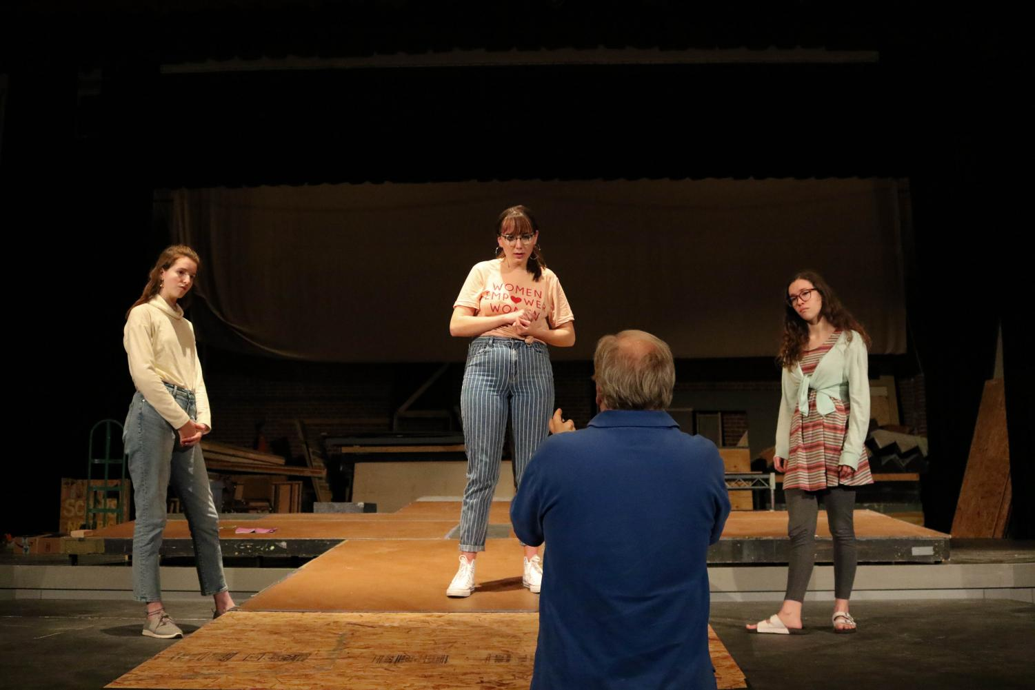Left to Right: Sophomores Isabel Ashley and Emory Rodda and senior Alyssa Glover absorb notes from Associate Professor of Theatre Tom Heiman. The play