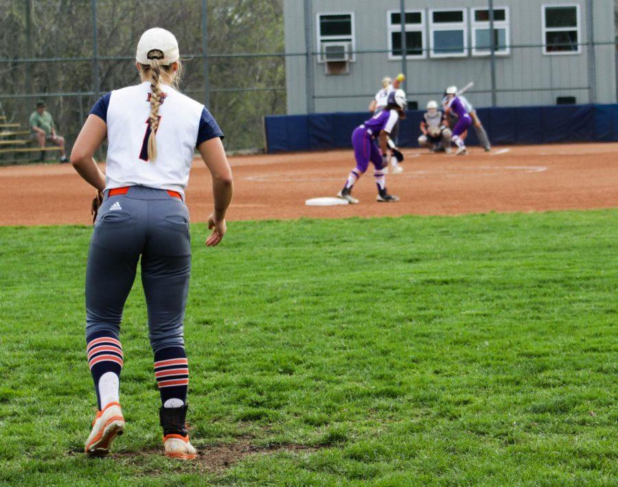 Junior Riley Swickard creeping in as senior Olivia Brees pitches against Missouri Valley.