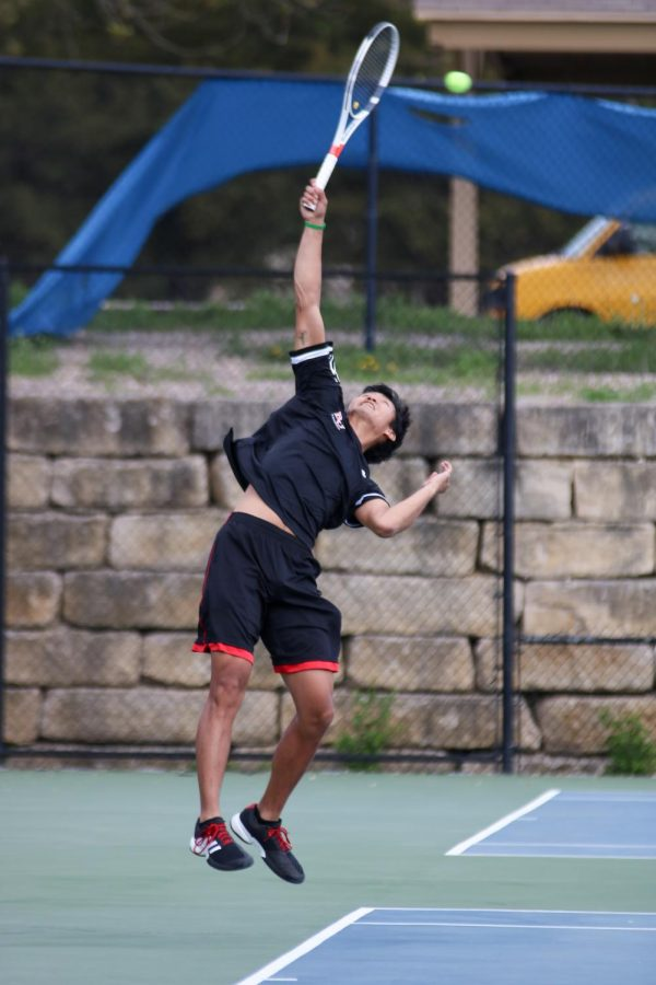Junior, Adam Ruckman serves the ball against Concordia. The Wildcats go on to win 5-4.