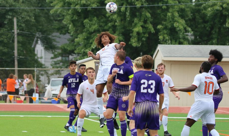 Sophomore Jordan Alonge rises to head a ball crossed in. Alonge scoring two goals against Avila University was a goal shy of a hat trick.