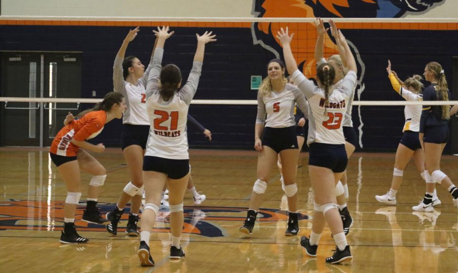 Baker+celebrates+a+block+by+senior+Makaila+Garcia.+The+%27Cats+record+11+block+against+William+Penn+University+in+a+3-0+sweep.