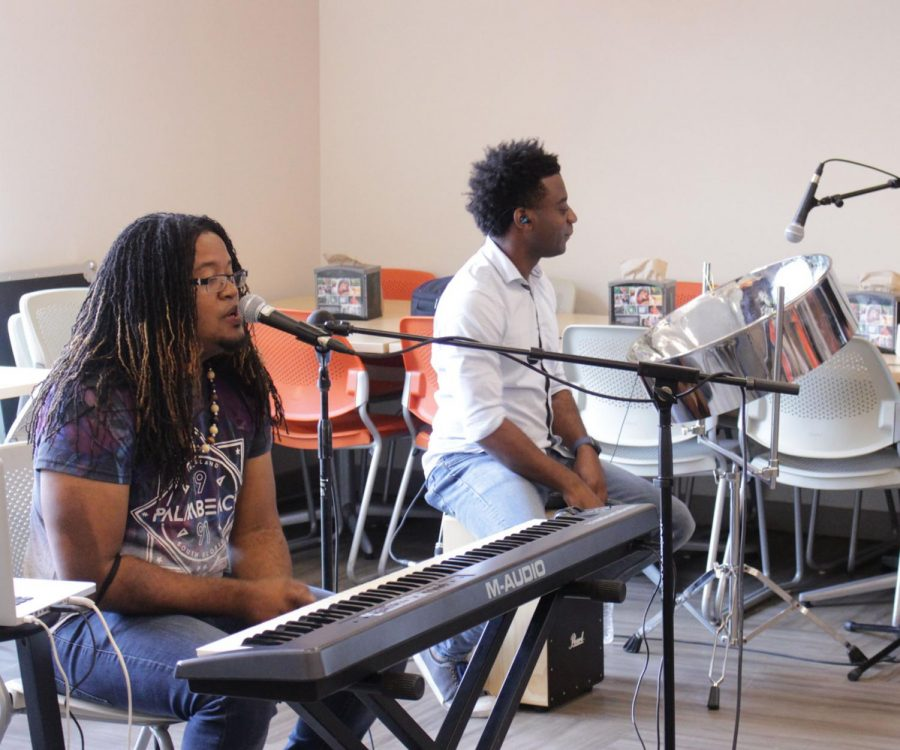 Wesu (front) and Andre (back) playing music for the Union Cafeteria on Sept. 10 at 11:30 AM. Andre is not only a steel pan, drum, keyboard or guitar player but also interested in nature photography.