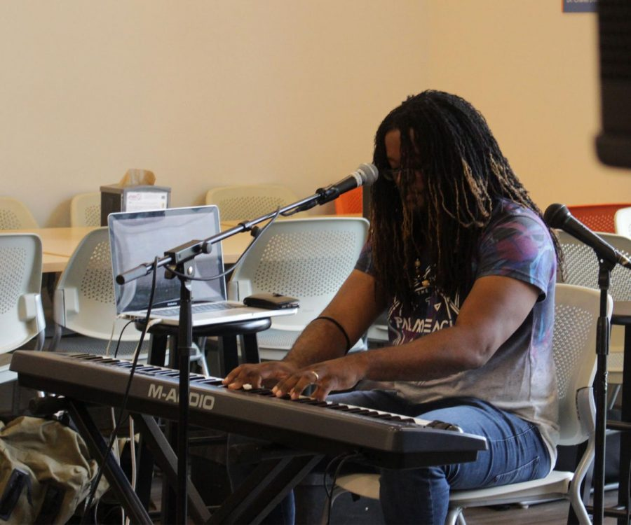 Wesu playing the keys for the Café. The band First Klass is originally from Barbados and was formed in 2018!