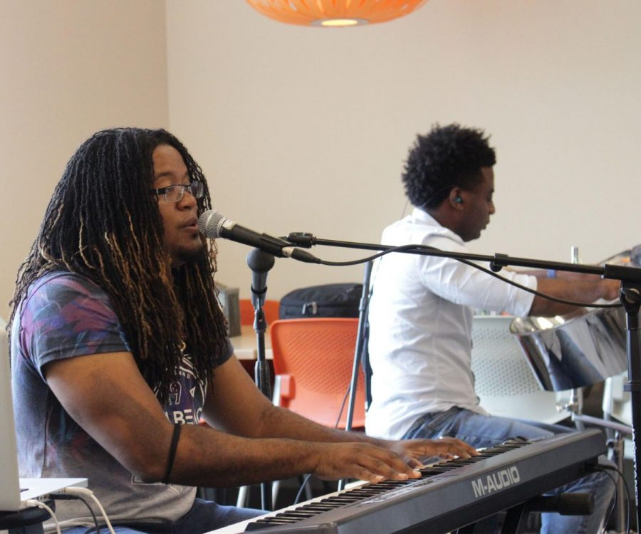 Wesu on Vocals and Keyboard (front) and steel pan player Andre (back) really compliments each other while playing their music.