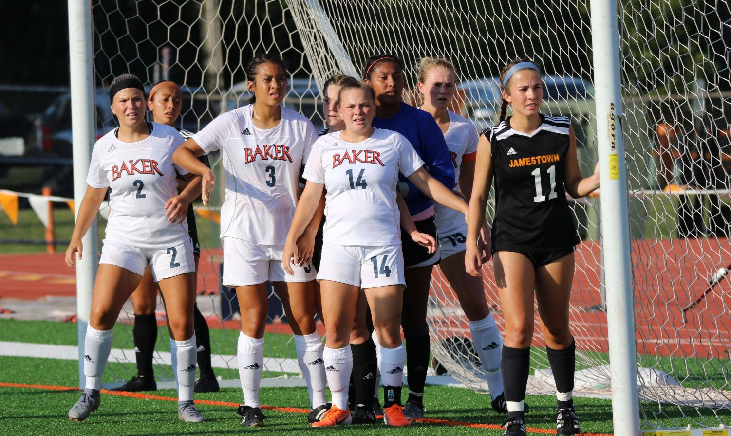 Baker players surround the goal keepers box on a corner kick. The 'Cats were able to slot one goal home in overtime with a total of 20 shots and eight on target against the University of Jamestown.