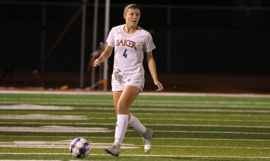 Freshman Lizzie Rollenhagen looking for a midfield upfield to make a run into space. Center forward and freshman Anna Chieu strikes the ball past the Bruins goalkeeper in double overtime to earn the 1-0 victory.
