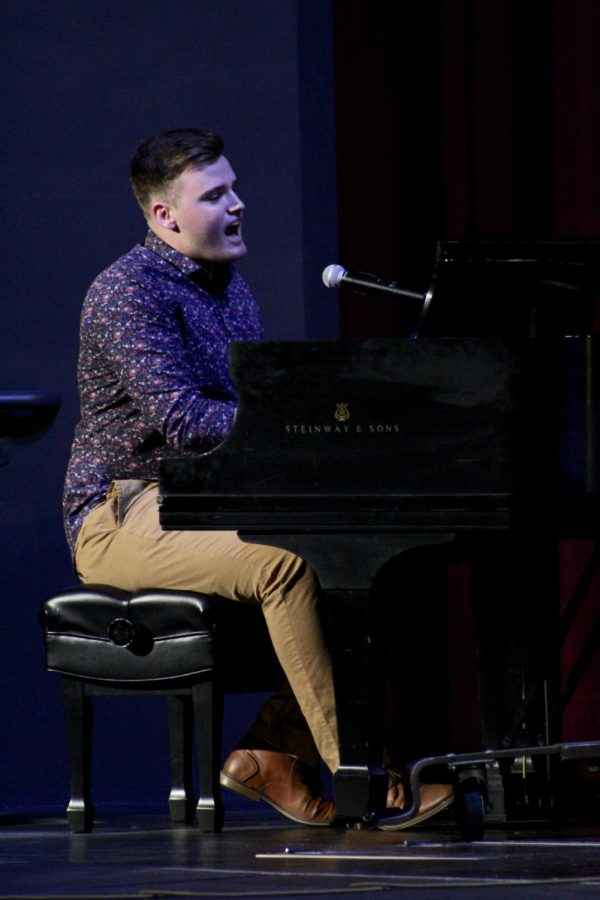 Carson Moore singing Viena Waits for you at the Baker's Got Talent event held during homecoming week.
