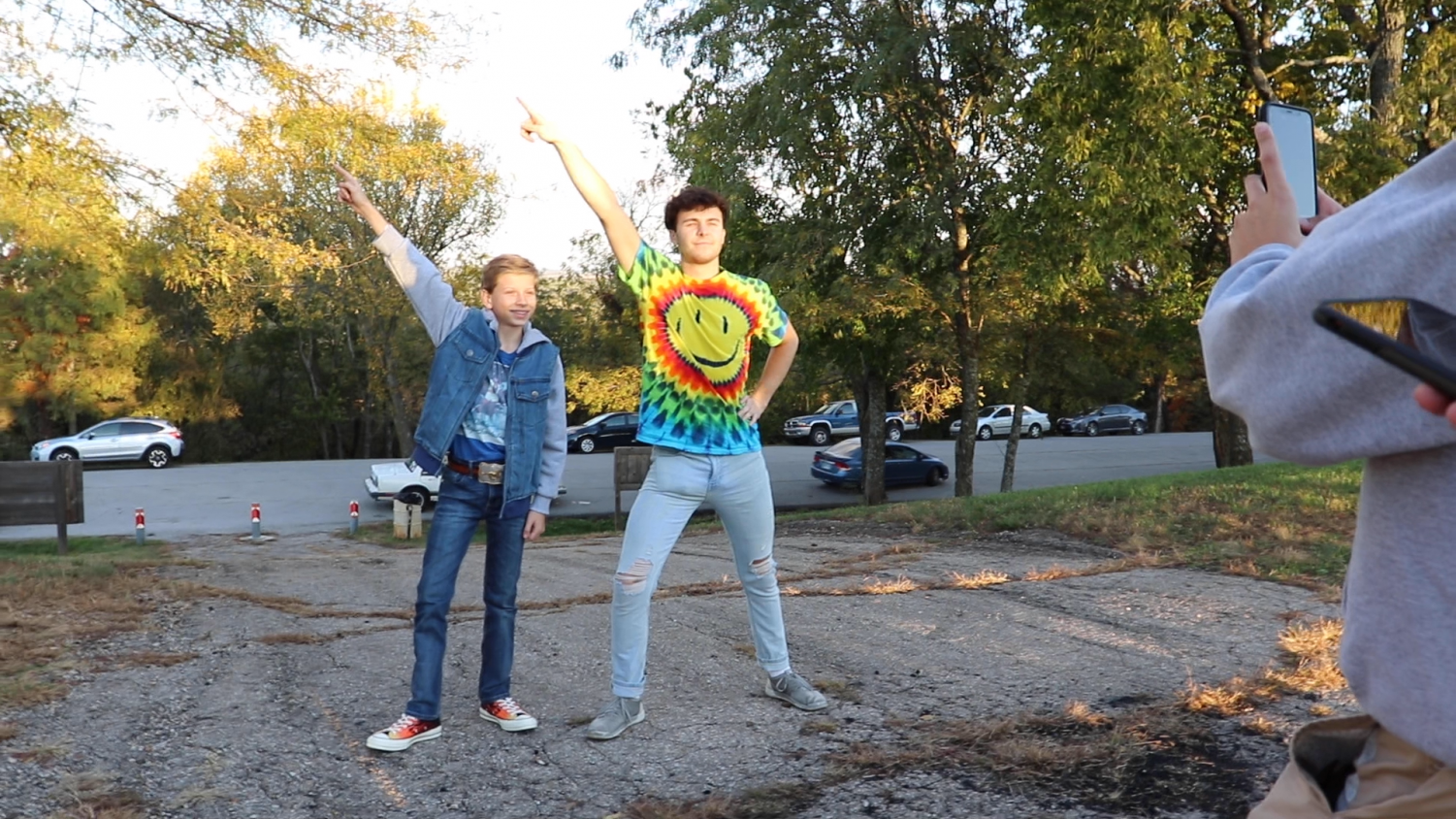12-year-old country star Mason Ramsey strikes a pose with Sophomore Brendan Hulla at Wells Overlook Park. Hulla is a member of Sigma Phi Epsilon, one of the greek houses that won a social media contest to meet Ramsey. Hulla said that he and his friends like to strike this pose together in photos, so he was excited to have a celebrity take part in the inside joke.