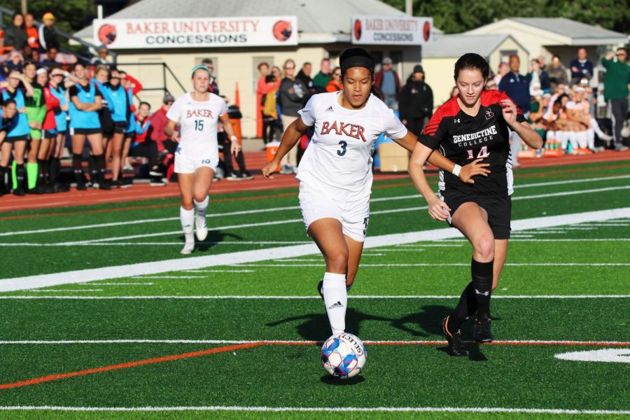 Freshman+Anna+Cheiu+holds+off+Benedictine+College+defender.+The+Ravens+sit+ranked+at+11th+in+the+nation+coming+into+Liston+Stadium+Oct.+12.+