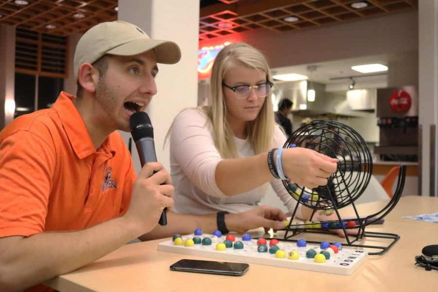 Juniors Dylan Kort and Madison Martin calling out letters and numbers for Baker bingo. This form of bingo allowed students to win Baker gear instead of groceries.