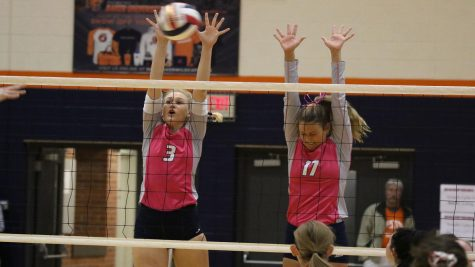 Ravens top Wildcats on dig pink night