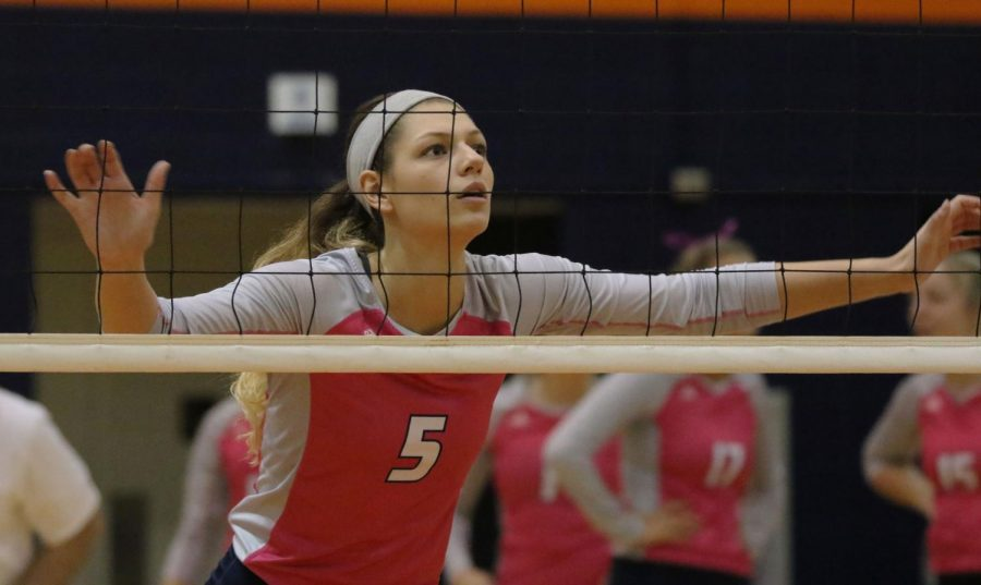 Senior Makaila Garcia awaits the Ravens serve during the second set. Garcia records 7 kills against the Ravens in a 0-3 series loss.