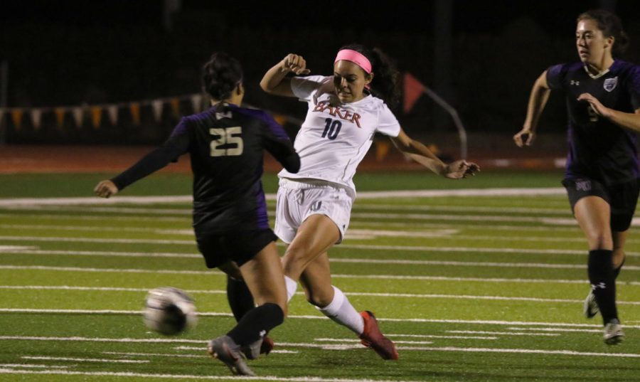 Junior Victoria Aceves-Powers challenged a Bruins midfielder. The deflected ball lands at the feet of Jenna Latimer for a chance at a cross and shot on net.