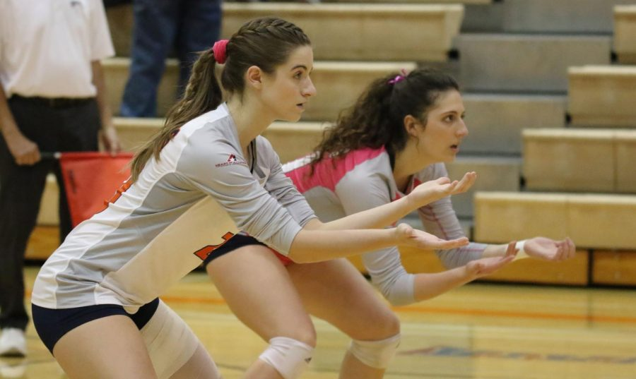 (Left) Junior libero Nicole Johnson along with junior Sophie Heldenbrand positioned for the Benedictine serve. Heldenbrand adds two total attempts of kills, errors, and zero attacks raising her to 480 on the season.
