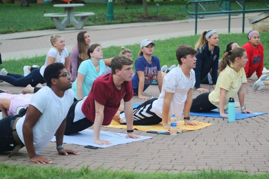 Students+participate+in+yoga+at+7%3A30+a.m.+outside+of+Hater+Student+Union+to+begin+homecoming+week+activities.+
